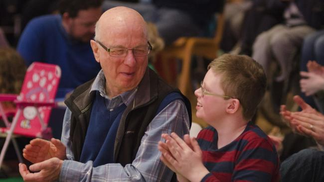 A grandfather and his grandson enjoying a 'relaxed' BSO concert