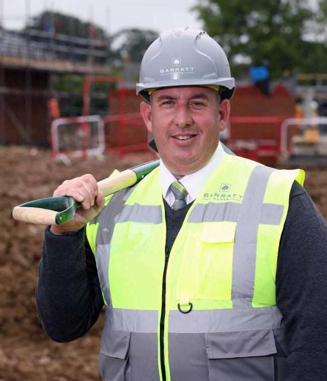 Site manager Brian Melrose get to work at Barratt Homes' Compass Point development