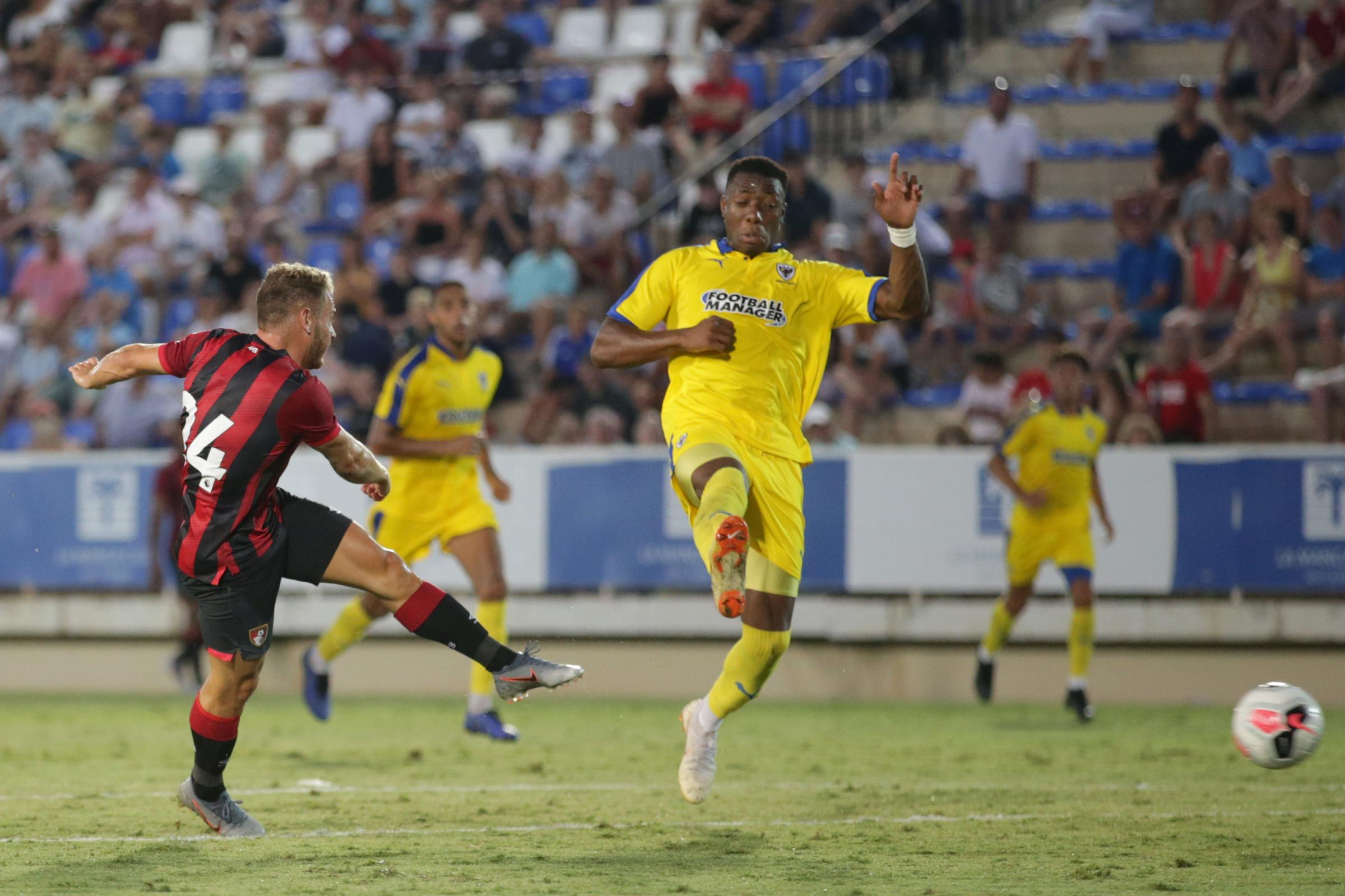 Ryan Fraser and Callum Wilson pick up where they left off to earn AFC Bournemouth a narrow win over AFC Wimbledon