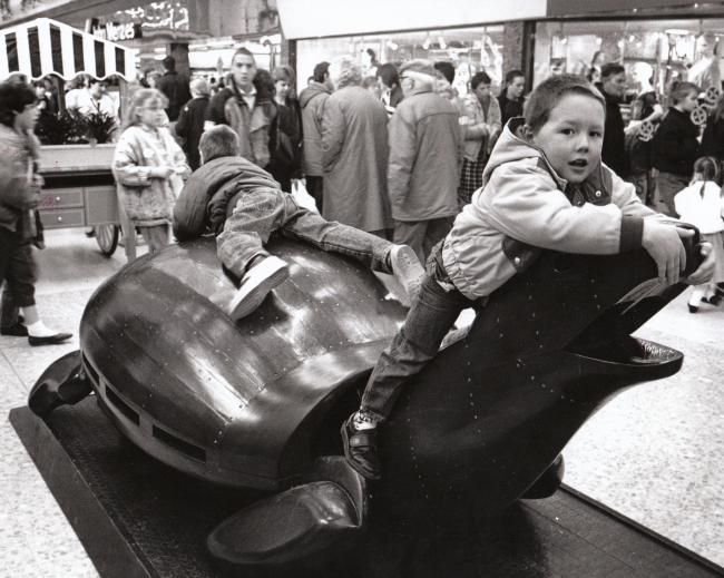 In 1989 two boys on a turtle, one of the wooden animals in the Dolphin Centre, Poole. In 1989 the shopping centre changed its name from the Arndale Centre to the Doplhin Centre..