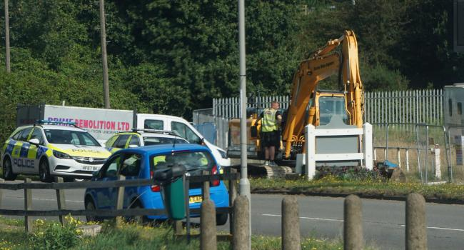 Workers at the former Upton Oil site, Blandford Road, where travellers moved onto on Friday
