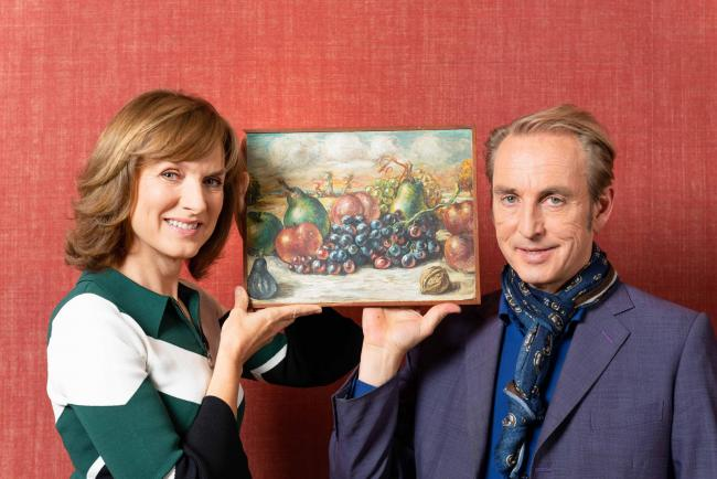 Fiona Bruce and Philip Mould, with a painting thought to be an original work by Giorgio de Chirico that has been confirmed as worthless. Photo: Todd-White Art Photography/Ben Fitzpatrick/BBC.