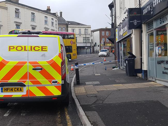Police at the scene of the assualt, at Bournemouth's Triangle, which left a man with serious head injuries