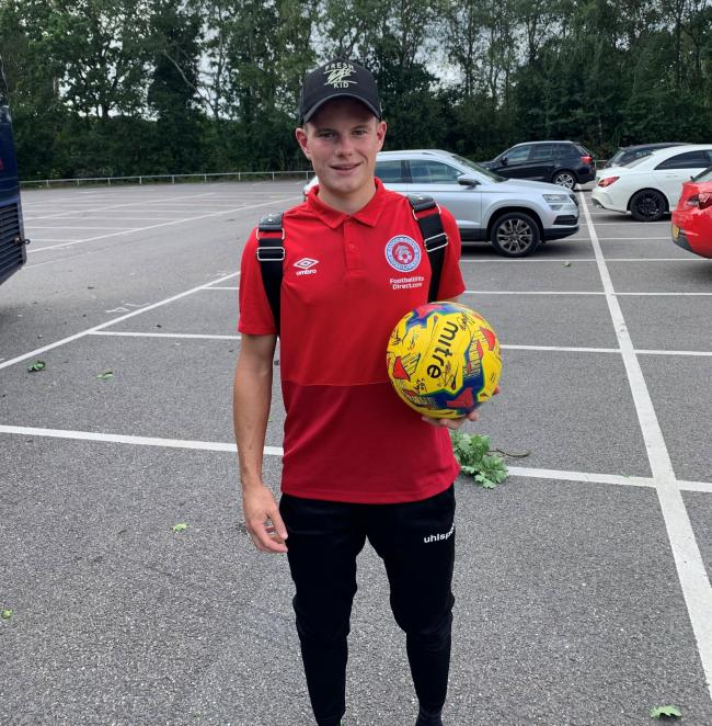 HAVING A BALL: Poole Town's Ollie Dennett takes home the match ball following his hat-trick at Farnborough (Picture: Jack Tanner)