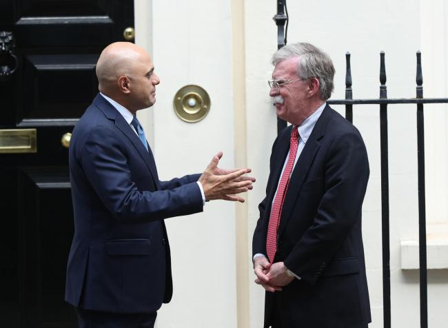 Chancellor Sajid Javid welcomes US National Security Advisor John Bolton ahead of a meeting at Downing Street, London. PRESS ASSOCIATION Photo. Picture date: Tuesday August 13, 2019. See PA story POLITICS Brexit. Photo credit should read: Yui Mok/PA Wire