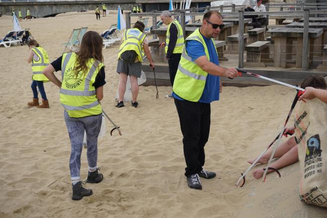 Volunteers for Leave Only Footprints picking up litter on Bournemouth Beach earlier this year