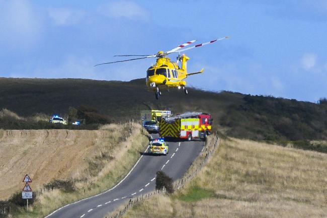 The air ambulance takes off from the scene of a serious accident on the B3157 coast road between Abbotsbury and Puncknowle.  1st September 2019.  Picture Credit: Graham Hunt Photography.