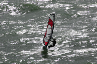 Bournemouth Echo: A windsurfer tests out the Boscombe Surf Reef. Picture by Richard Crease.