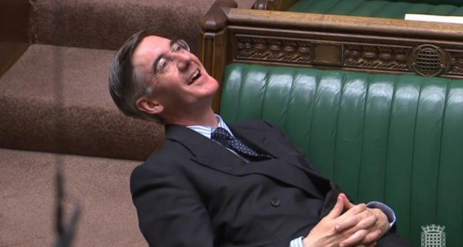 Jacob Rees-Mogg reclining on his seat in the House of Commons