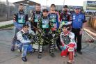 Poole Pirates septet with team boss Neil Middleditch ahead of the meeting