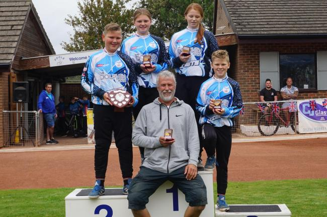 CHAMPIONS: Poole Comets under-12s Ollie Saunders, Lexi Curtis, Daisy Sherwood, Kenzie Bennett with team manager Neil Garnett (Picture: Arthur Lawrence)