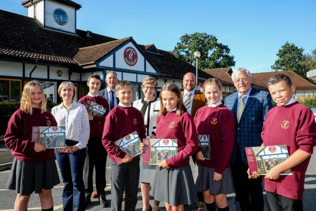 Pictured with pupils are Leanne Page chair of the local academy committee, executive head teacher Ron Jenkinson, Wimborne Academy Trust CEO Liz West, head of school Rob Christopher and chair of trustees John Dickson