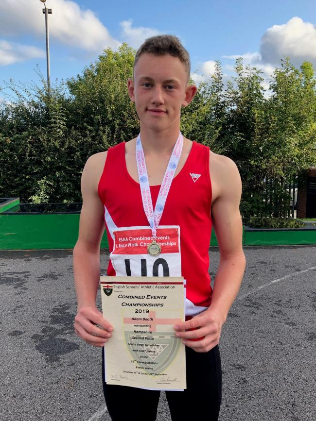Adam Both with his silver medal at the Silver for Adam at English Schools' Combined Events Championship