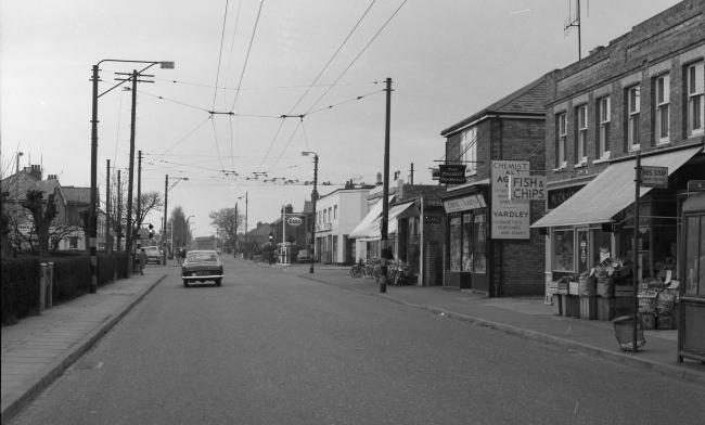 This photo taken circa 1968 shows Wallisdown Road at the junction with Alder Road and Kinson Road that now features the Wallisdown roundabout. The Esso Garage in the centre of the photo is now the home of Pets Corner and Merv Hannam with the majority of t