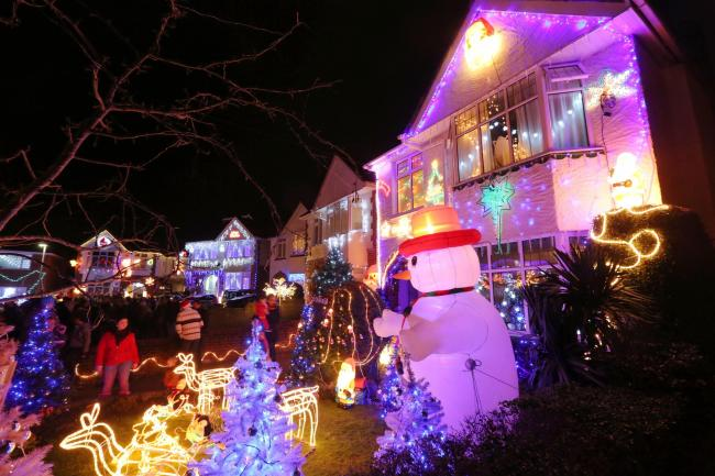 The Christmas lights come on in Runton Road, Poole, Dorset..