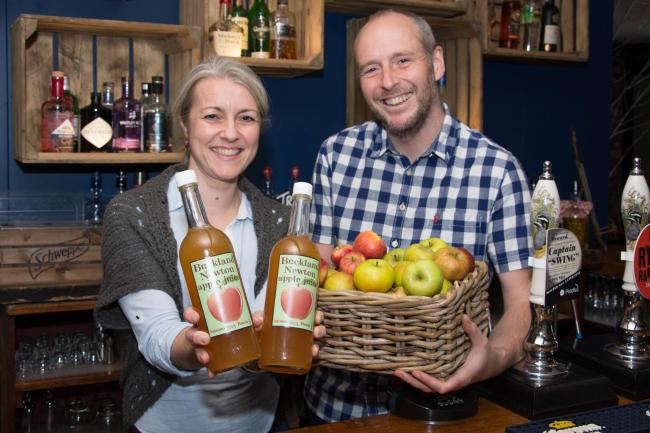 Simon and Sarah Colquhoun behind the bar with the juice