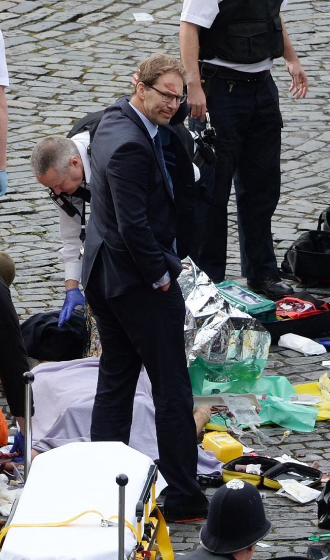A bloodied Mr Ellwood at the scene of the Westminster terror attack