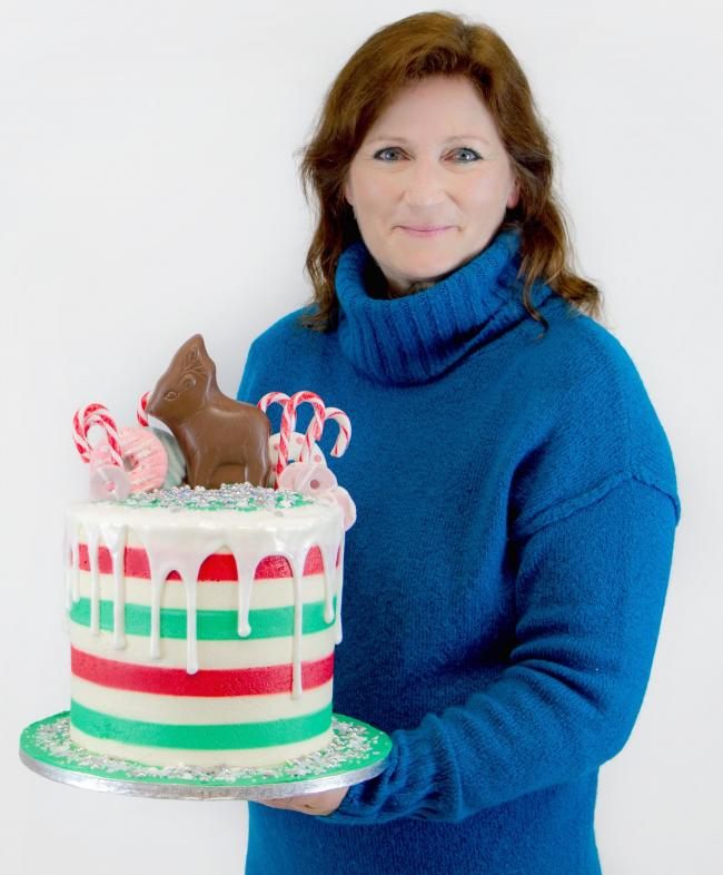 Annette Langley-Tayler with one of her cakes. Credit: Chantelle, Aurora Photography and Media