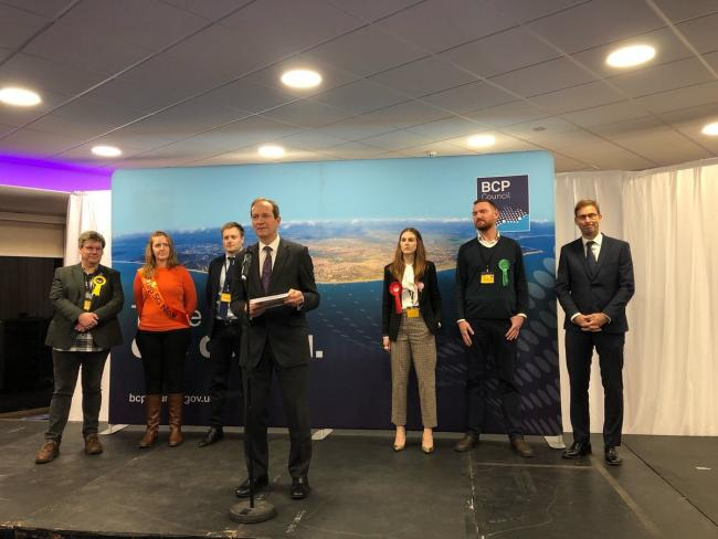 Graham Farrant, Acting Returning Officer and BCP Council Chief Executive announces Tobias Ellwood as winner of Bournemouth East at the BIC on December 13, 2019, during the 2019 general election. Picture by BCP Council.