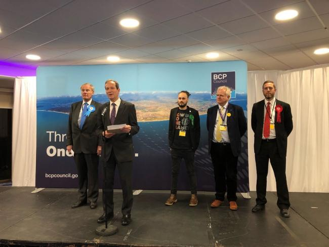 Graham Farrant, Acting Returning Officer and BCP Council Chief Executive announces Sir Chris Chope as winner of Christchurch at the BIC on December 13, 2019, during the 2019 general election. Picture by BCP Council.