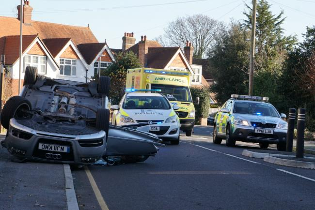 Emergency services deal with an overturned Audi A3 in Alexandra Road, Parkstone