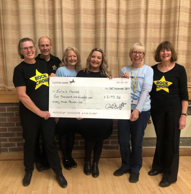 n Stacey Hobday, the Rock Choir leader, together with Sue and Alan Pike, Trudi Baker and Jane Evans from the Choirs and Gill Slade from the Dorchester Friends of Julia's House