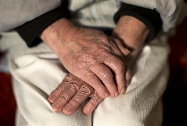 The hands of an elderly woman in Poole, Dorset..