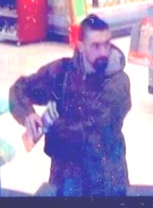CCTV IMAGE: Stephen Clark in Asda, Canford Heath on Monday (October 26)