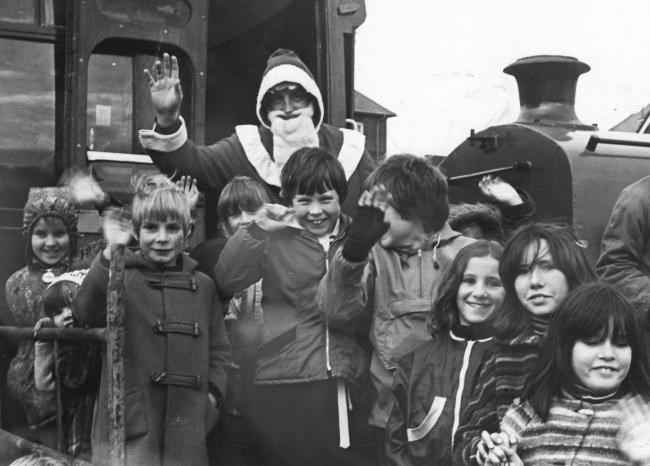 In 1979 children greeted Santa when he arrived by train at Swanage Railway Station. He then led the Christmas parade round the town. Photo by Artur Grant