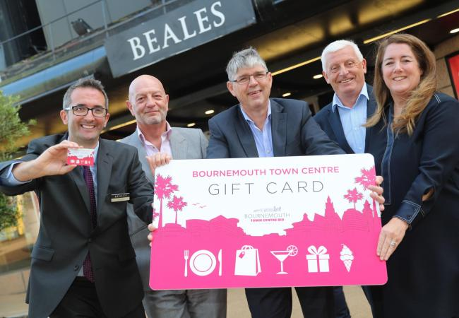 The Bournemouth Town Centre Gift Card. Beales store director Carmine Cafolla, Bournemouth Town Centre BID Chef Operating Officer Paul Kinvig, Bournemouth Town Centre BID Chairman Martin Davies with Andy Martin and Tracy Hayden of the Daily Echo.