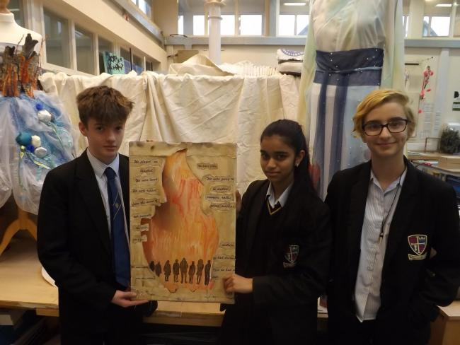 Students with the memorial flame artwork