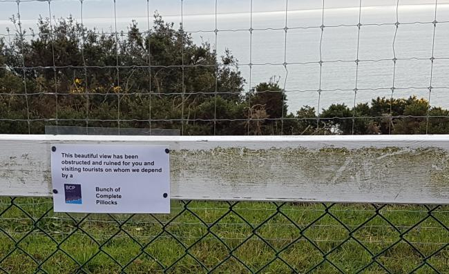 A sign erected on the controversial goat fence, which has been extended on the East Cliff