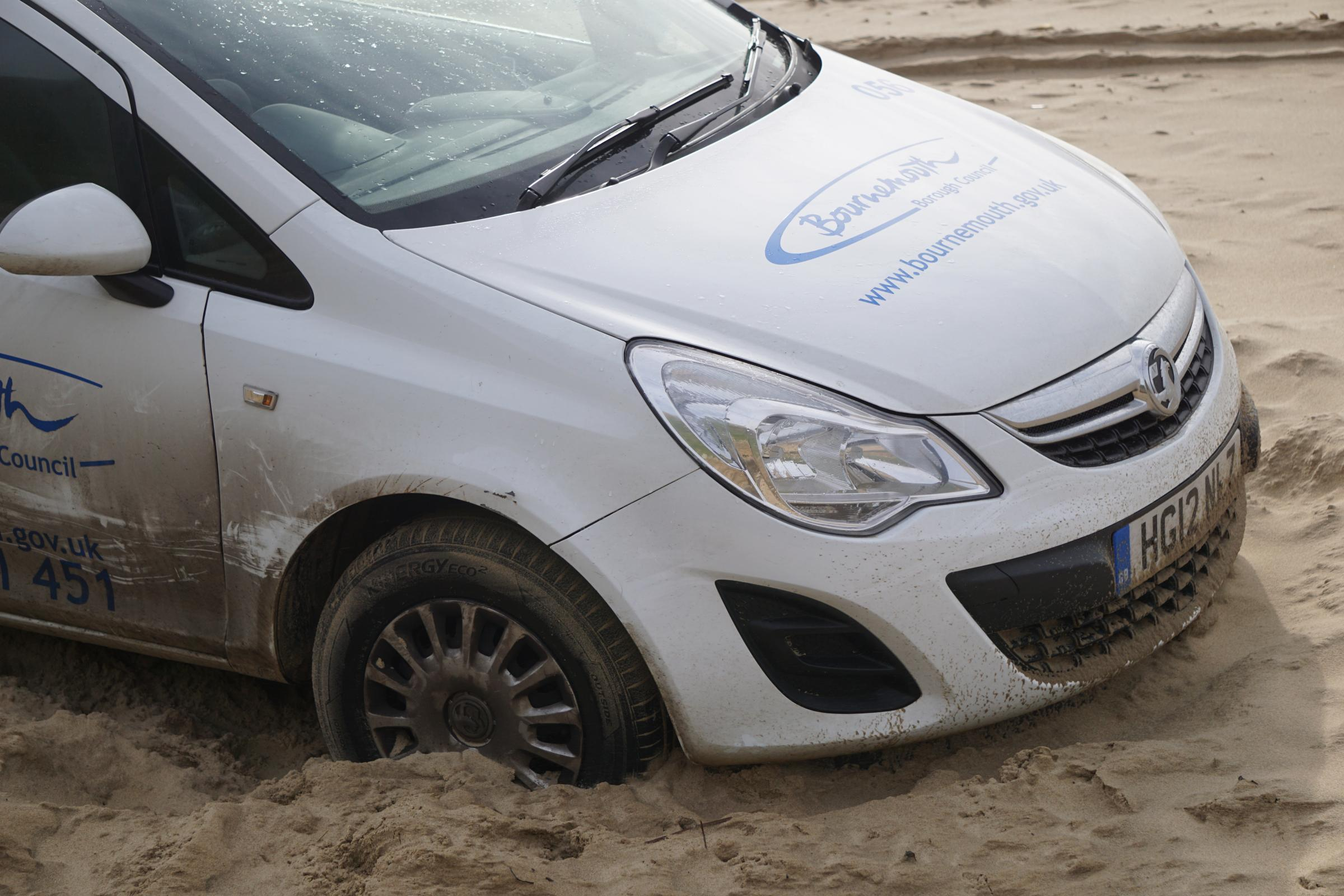 Council-owned Vauxhall Corsa caught in sand on Southbourne Beach