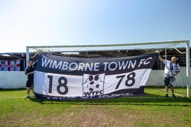 Wimborne fans Luke Coakes and Dan Short getting the flags ready for the Evo Stik playoff final between Wimborne Town and Swindon Supermarine, played at Cuthbury, Wimborne on Monday 7th May 2018. (Picture: Simon Carlton).