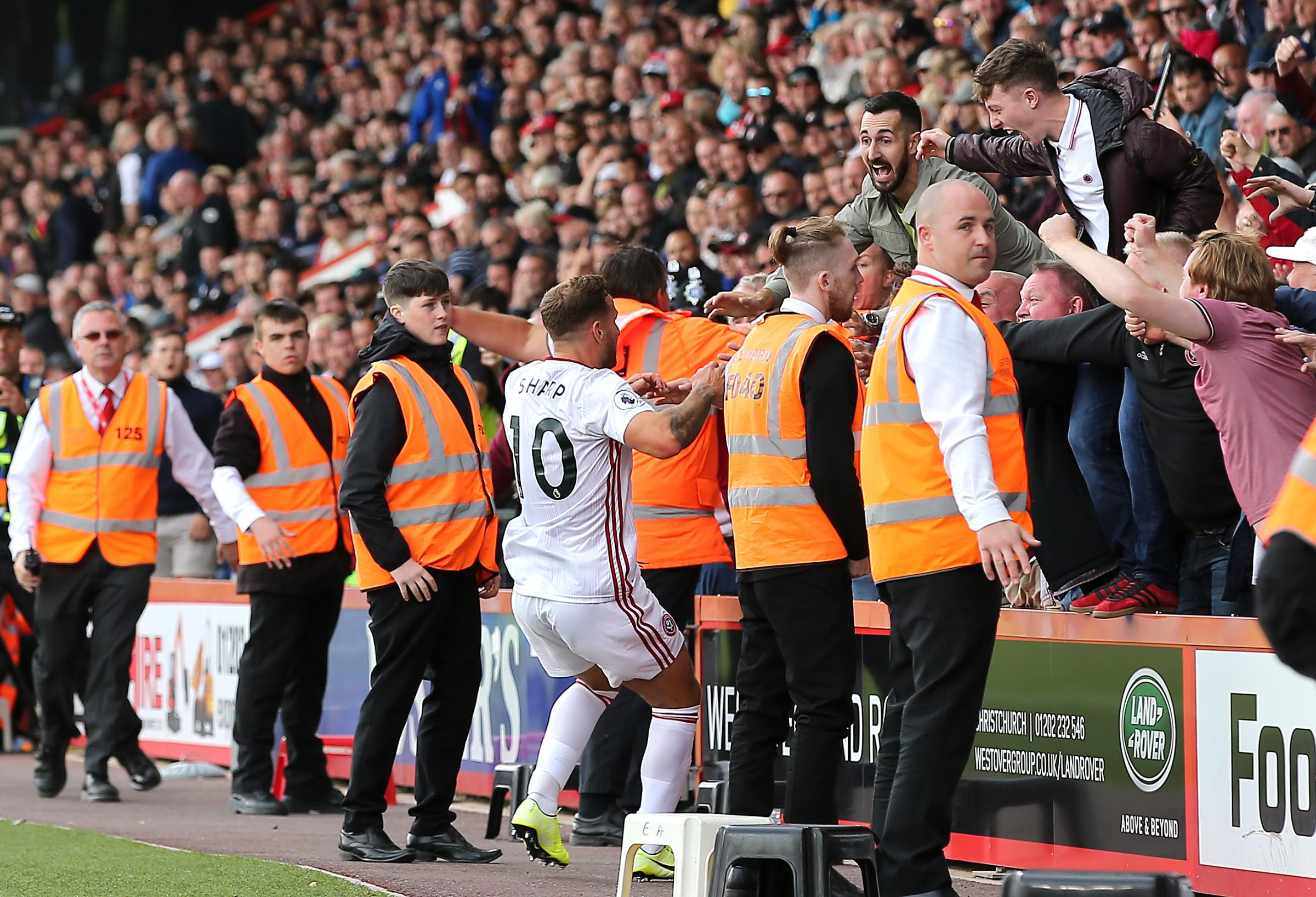 'The worst thing was my son's face, total embarrassment': Sheffield United fans in court after celebrations spill over advertising boards in draw with Cherries