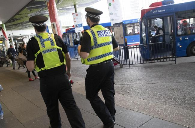 Police officers on anti-social behaviour patrol in Poole. .The team stop to have a friendly chat to children who were not causing any issues at Poole Bus Station
