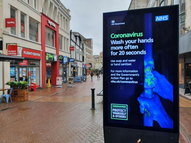 Coronavirus warning advert in Bournemouth town centre. Picture: PA