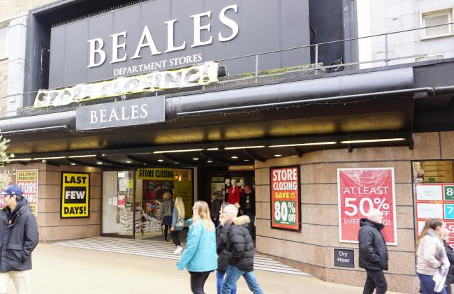 "Signs at Beales in Bournemouth advertise the ""last few days"" of a closing down sale"