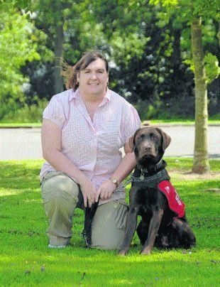 EARLY WARNING SYSTEM: Karen Ruddlesden and dog Coco, trained to detect her Addison's disease