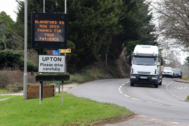 A sign in Upton stating that Blandford Road has reopened..