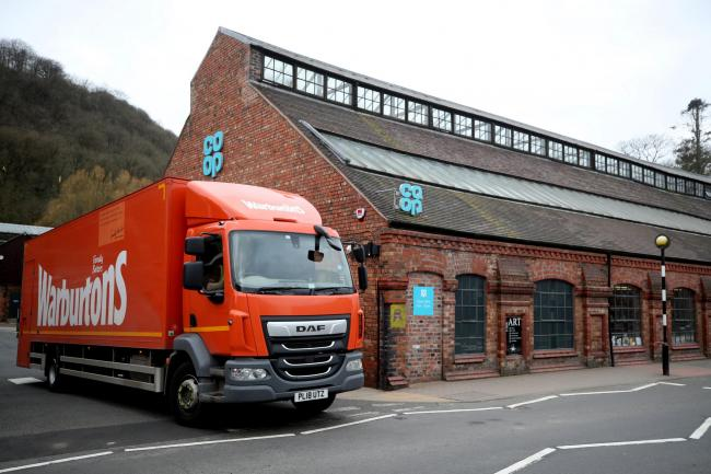 A Warburtons van makes a delivery to a Co-op supermarket in Ironbridge as the UK continues in lockdown to help curb the spread of the coronavirus. PA Photo. Picture date: Monday March 30, 2020. A total of 1,228 patients are reported to have died after tes