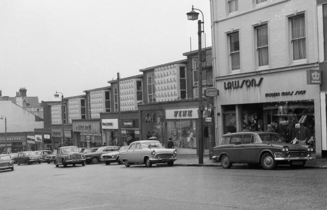 The shops in Commercial Road, Bournemouth, pictured here in the early 1970's before redevelopment and the road was closed to traffic and became pedestrian only.  Featuring shops, Lawsons – Modern mans shop, Vision Hire, Paige, Pricerite, Freem