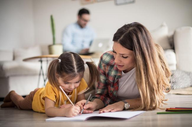 A family working and homeschooling together. Picture: iStock/PA
