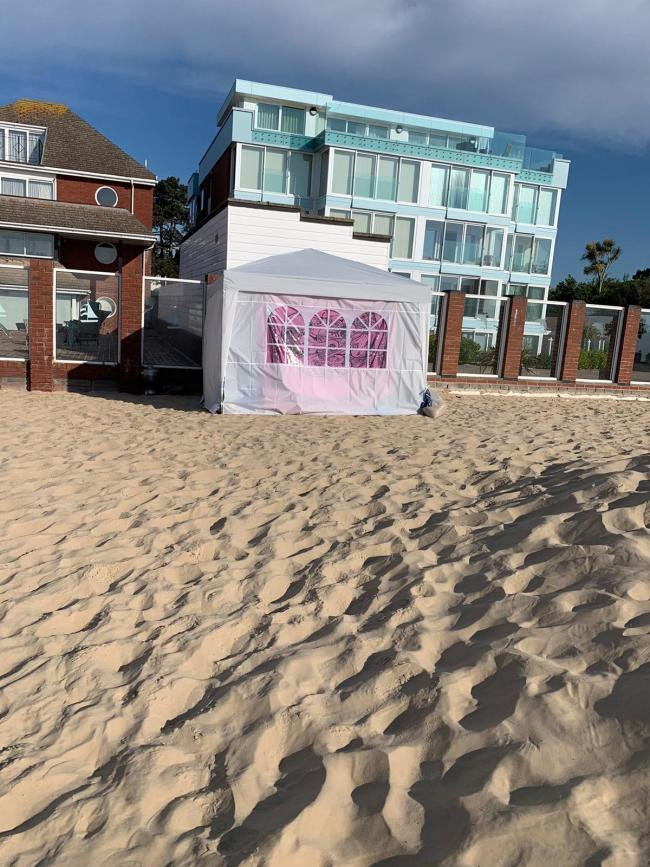 Tourists from London were fined after sleeping in a gazebo tent on Sandbanks beach
