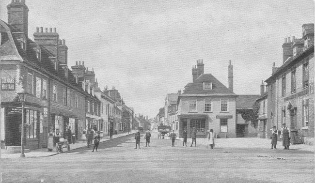 This fascinating postcard of West Street in Wareham gives a snapshot of the town during the early 1900. The Red Lion public house to the right is still featured today.