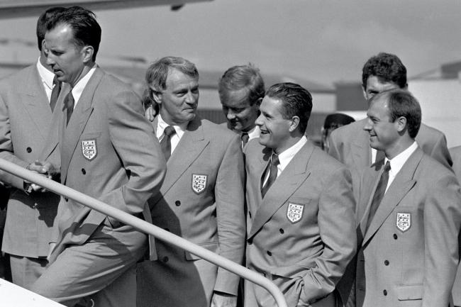 Paul Gascoigne (third left) shares a joke with England manager Bobby Robson (second left) as the squad prepares to leave Luton and fly to Italy for the 1990 World Cup finals