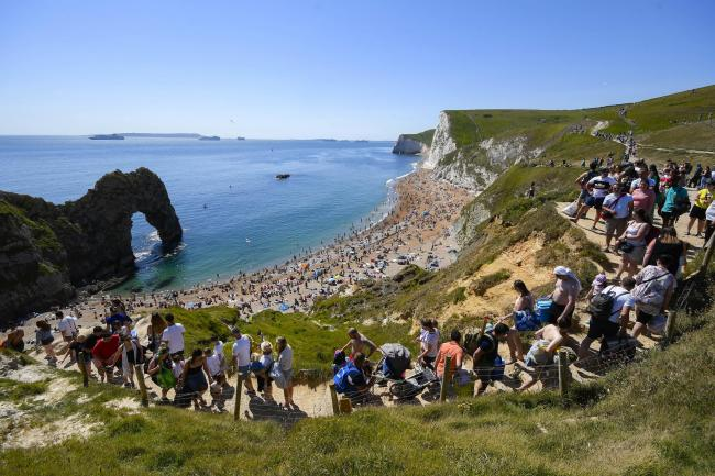 People pack the steps from top to bottom to reach the beach at Durdle Door on Bank Holiday MondayPicture: GRAHAM HUNT PHOTOGRAPHY