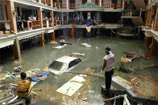 DEVASTATION: A rescue and clean-up crew survey a flooded lobby at the Seapearl Beach Hotel along Patong Beach on Phuket Island, Thailand