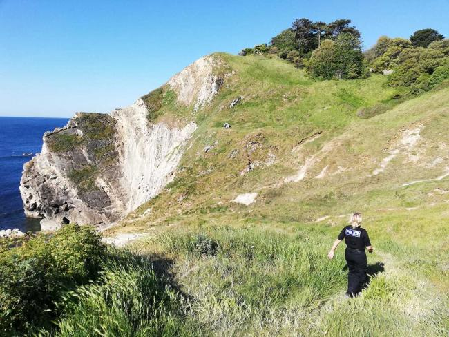 Campers had to be asked to leave crumbling cliffs at Lulworth Cover=. Picture: Purbeck Police