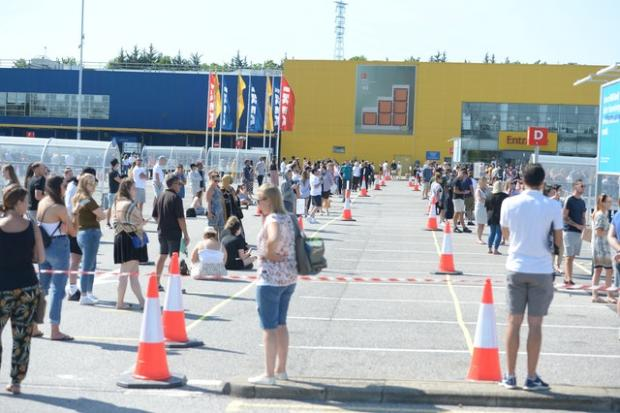 Bournemouth Echo: Customers queued two metres apart to get inside Ikea in Lakeside, Essex. Picture: Nick Ansell/PA Wire